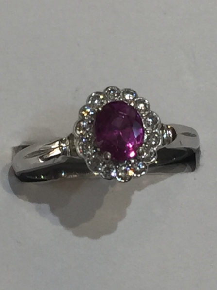 18ct white gold.  Fine colour ruby with VVS1 diamonds around.  £4,500