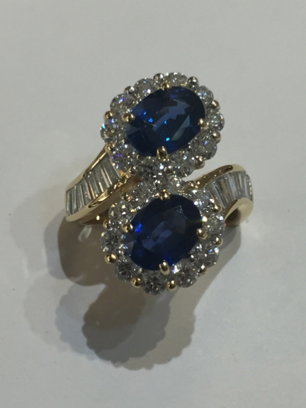 A fabulous Sapphire & Diamond Ring.  Really fine colour sapphires with baguette cut diamonds to the shoulders.  18ct yellow & white gold.  £14,000